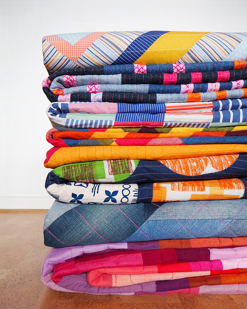 Stack of Stitch & Yarn quilts