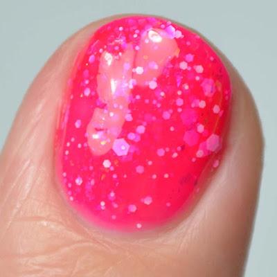 bright pink nail polish close up swatch