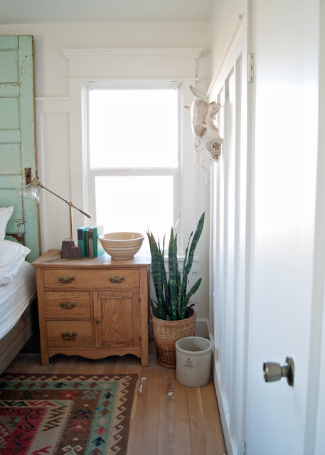 Farmhouse Master Bedroom Reveal - snake plant, basket, crock, antique washstand