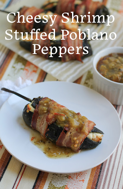 Food Lust People Love: These cheesy shrimp stuffed poblano peppers are wrapped in bacon and roasted till the bacon is crispy and the cheese is soft and melted. They make a fabulous starter or even a good main course, served with sides.