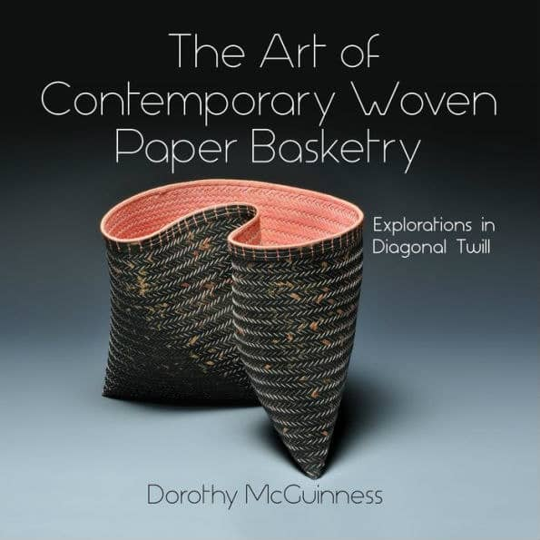 woven paper basket on book cover
