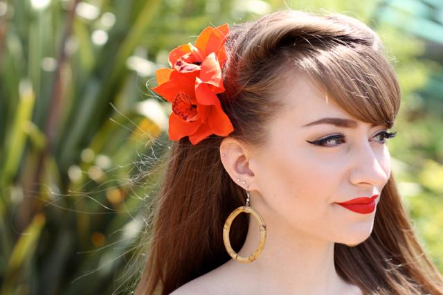 Bow & Crossbones large bamboo hoop tiki earrings with orange hair flower