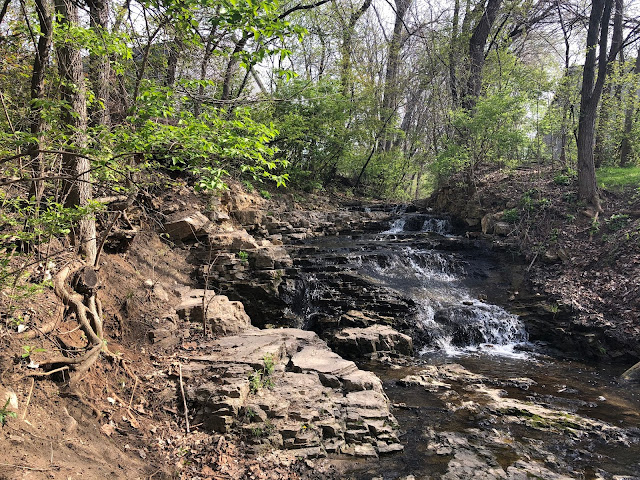 The silver threads of the waterfall in Bettendorf, Iowa shimmer as they tumble.