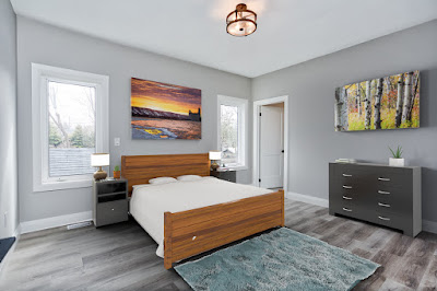 a bedroom fully furnished in a realistic fashion and lighting that would pass for a photo however everything is virtually staged and constructed digitially.
