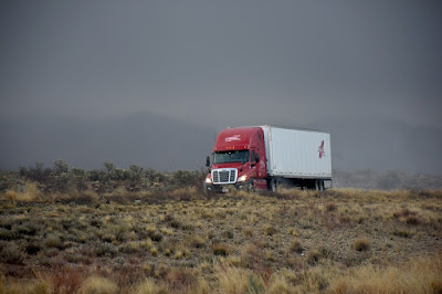A truck driving on an interstate road.