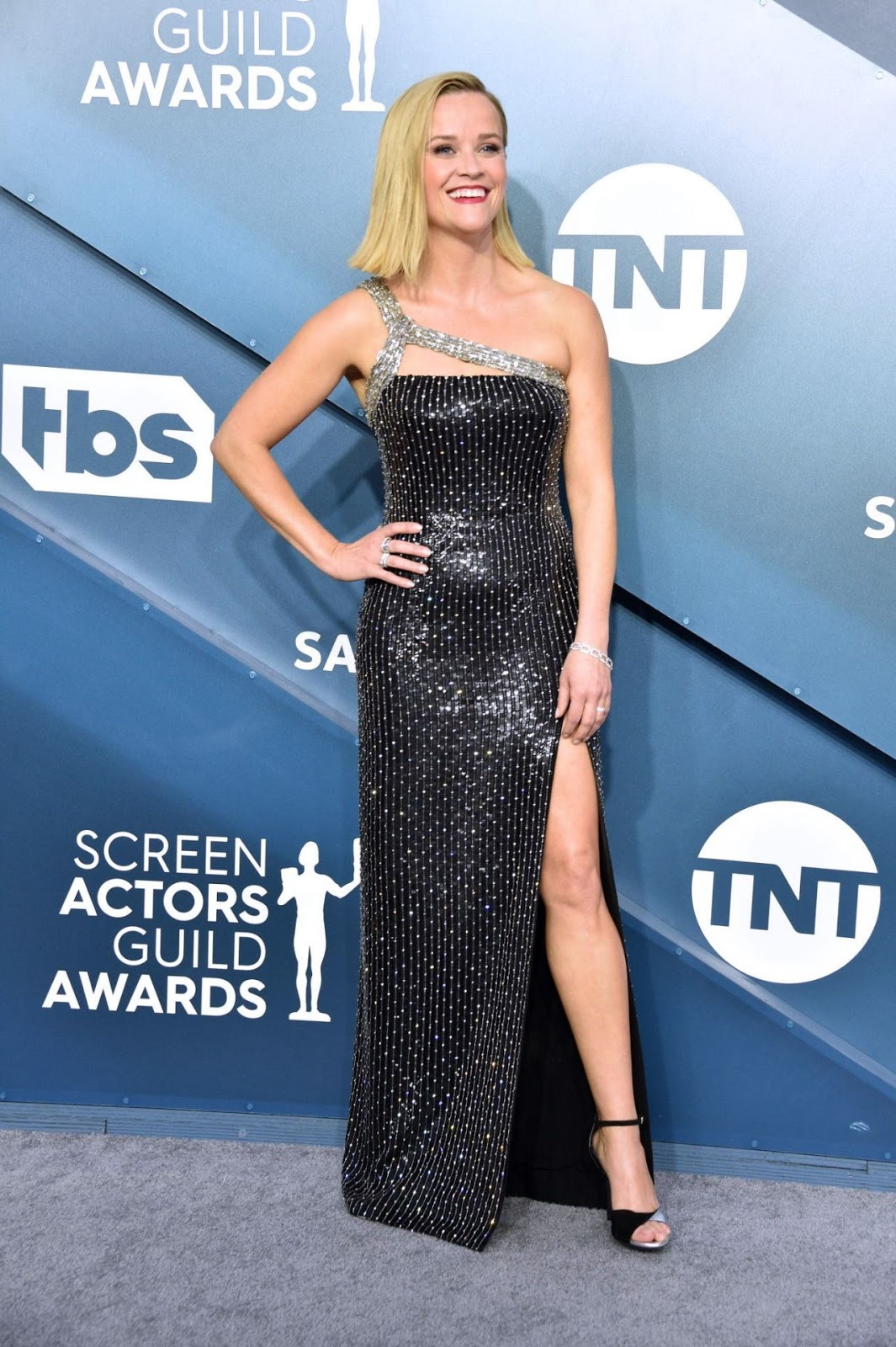 Reese Witherspoon puts on a leggy display in dazzling shimmery black gown as she represents Big Little Lies at SAG Awards