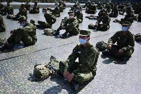 Japan cabinet approves record $52 billion budget, higher defence spending