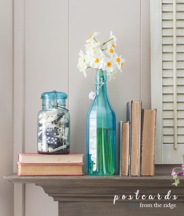 vintage blue mason jars with old dominoes used as decor