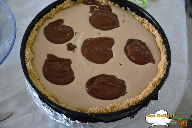 dollops of chocolate on cheesecake