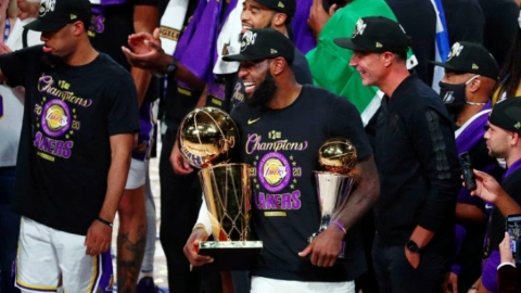 Watching: LeBron James jokes with the Larry O'Brien Cup about cheating on him