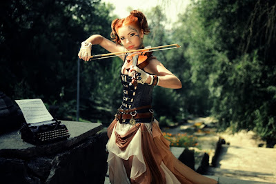 Women's steampunk fashion includes skirt, corset and gloves.