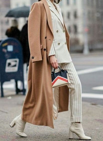 Camel coat over white suit