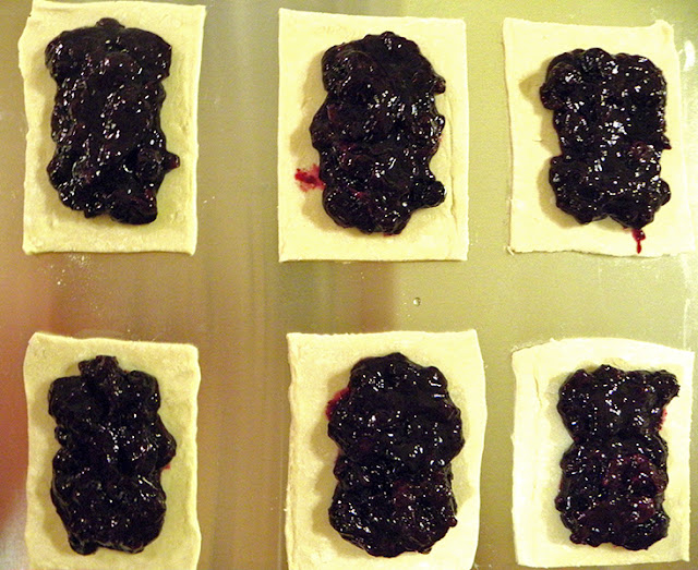 6 pastry rectangles with blueberry filling on top