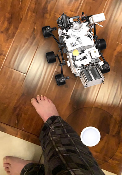 Resident Astronomer, in PJs, drives the Mission to Mars AR app (Source: Palmia Observatory)