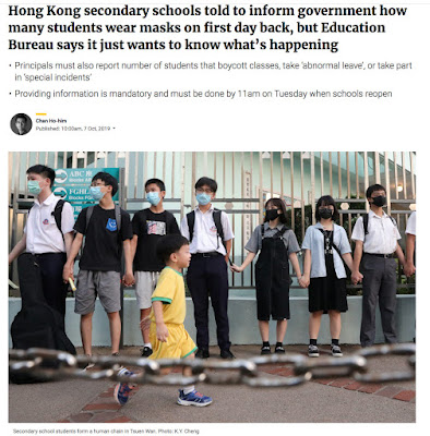 Hong Kong highschool students form human-chain around their school