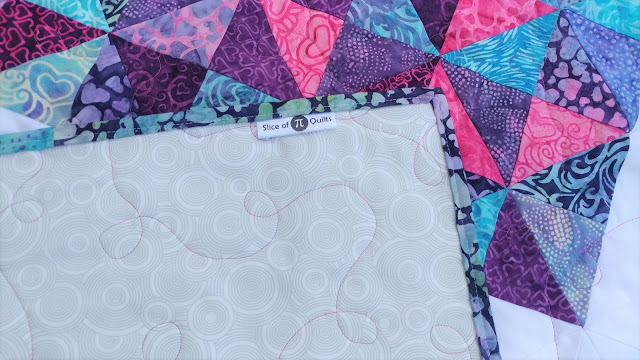 Satin quilt label sewn into binding