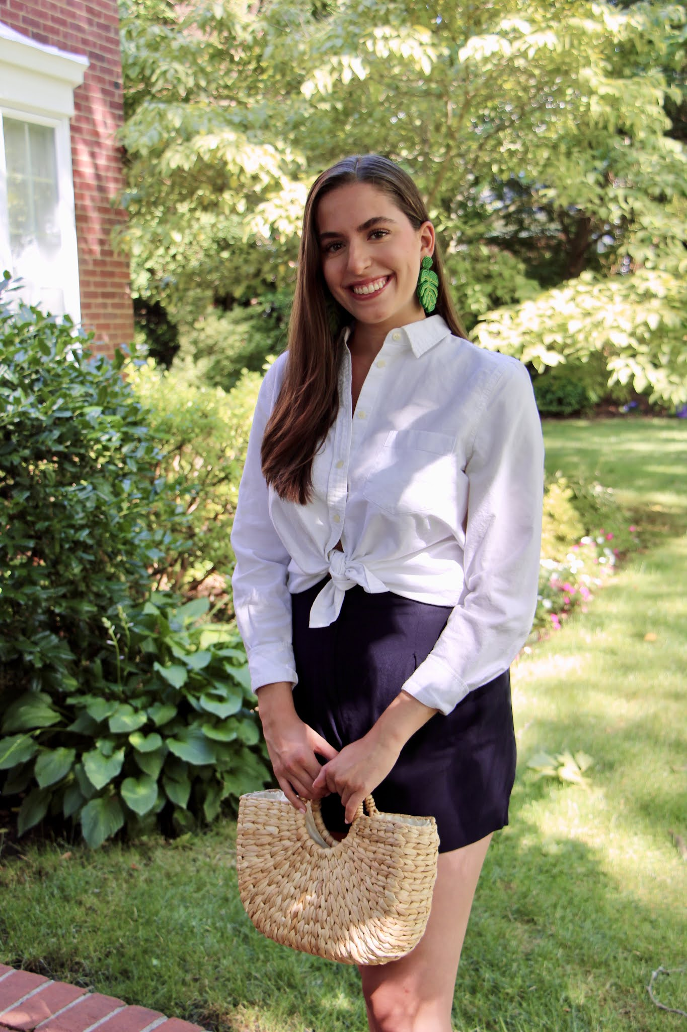 straw tote, straw bag, white button down, green earrings, statement earrings, shorts, preppy
