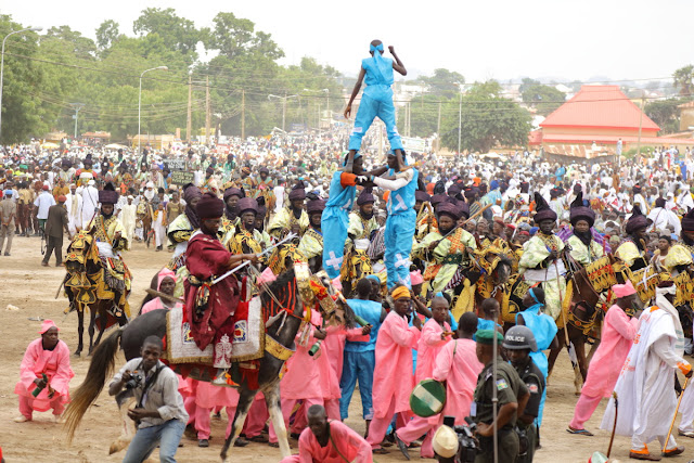 when acrobats compete with traditional horsemen at the Durbar