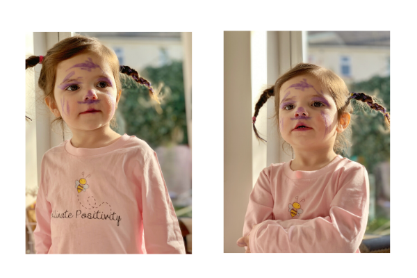 Charlotte with purple felt tip all over her face and a pollinate positivity top