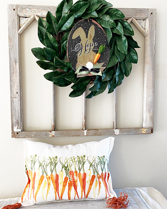 Old window with wreath and carrot pillow
