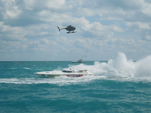 race boat and helicopter