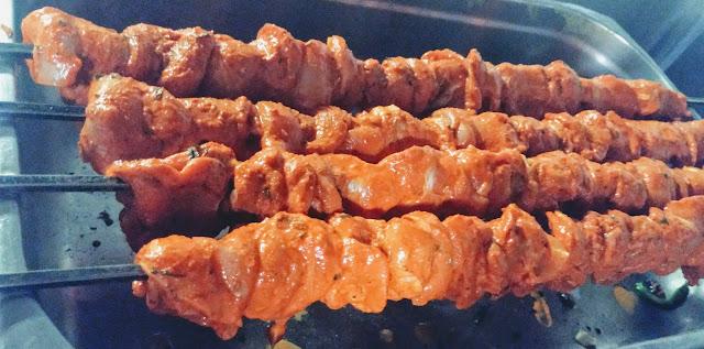 Marinated chicken pieces shew in Shewer for chicken Tikka