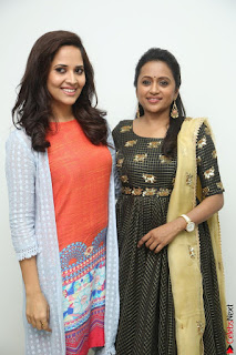 Actress Suma in Black Salwar Suit and Anusuya in orange Dress at winner movie press meet part 1 February 2017 (20).JPG