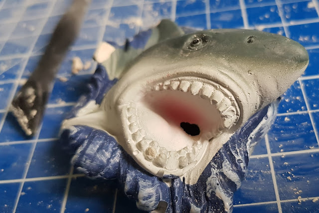 shark shaped plaster model with hidden shark tooth inside