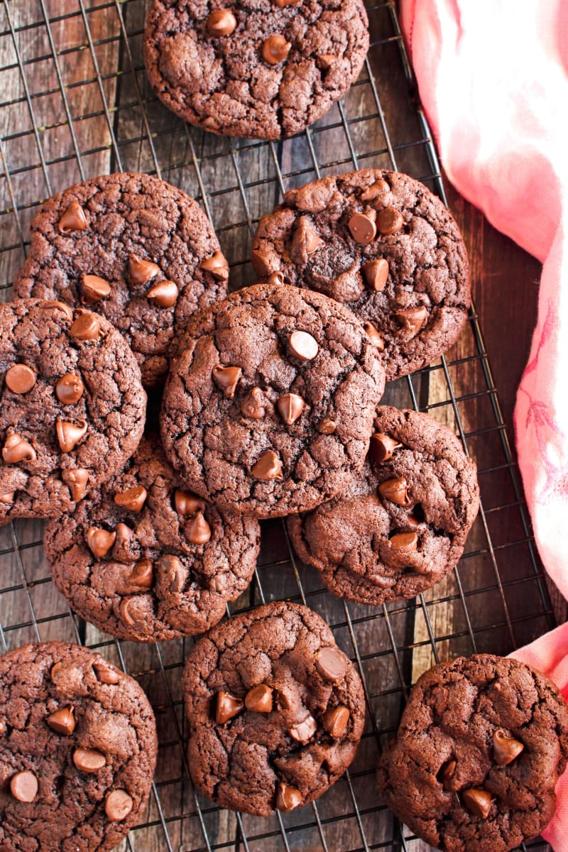 Top view of Triple Chocolate Cake Mix Cookies on a cooling rack on a wood surface.