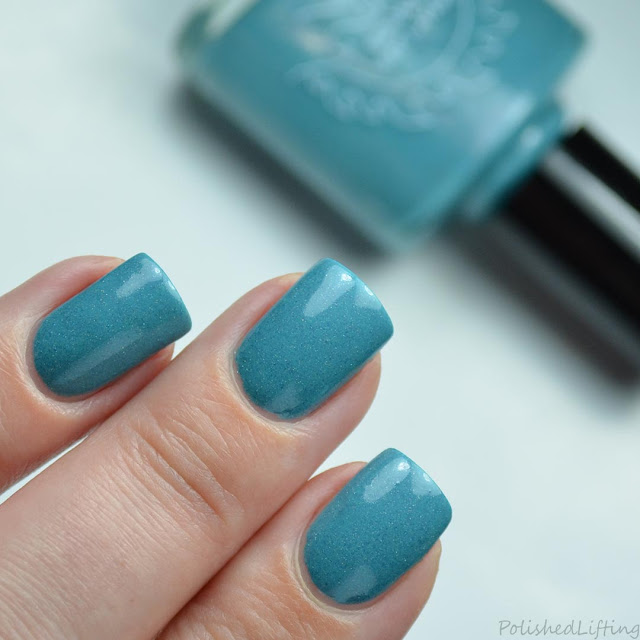 teal nail polish with holo