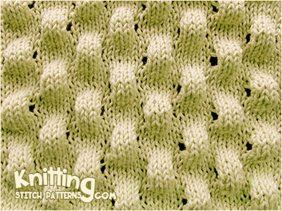 Puff stitch knitting. Very eye catching effect and not difficult to knit.