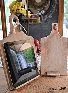 Wooden DIY ipad stands made from repurposed cutting boards.