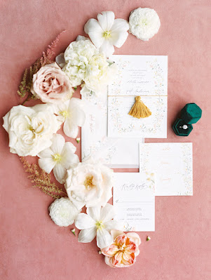 wedding invitation suite and flowers