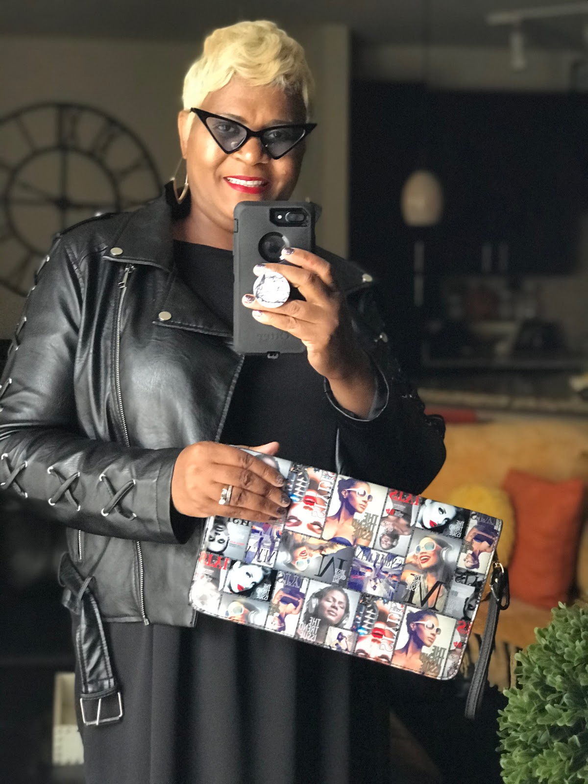 Tangie Bell sharing her outfit and magazine clutch bag before heading out to do DIY sale shopping