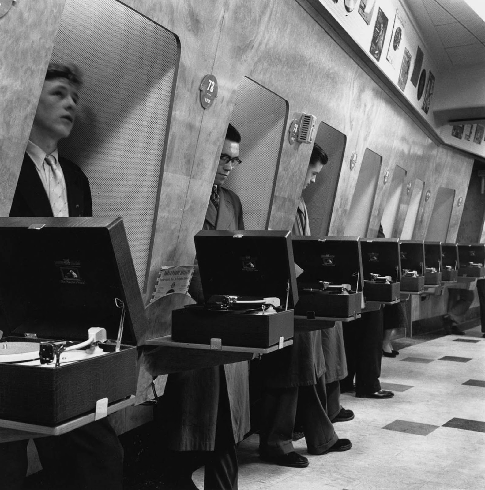 Young men listening to songs in a special listening booth. 1954.