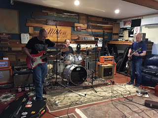 Peter, Keith and Paul tuning up their instruments