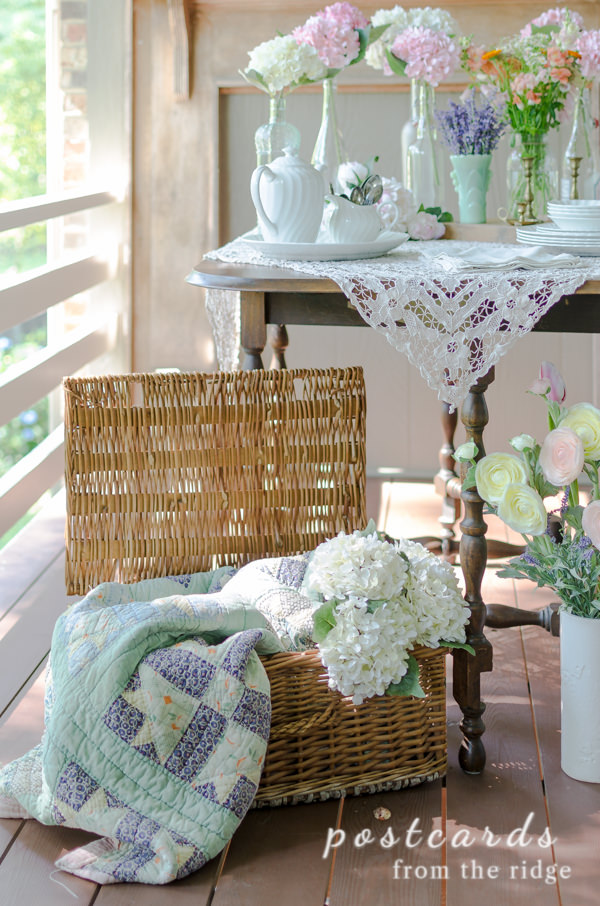 vintage wicker basket with quilt and hydrangeas