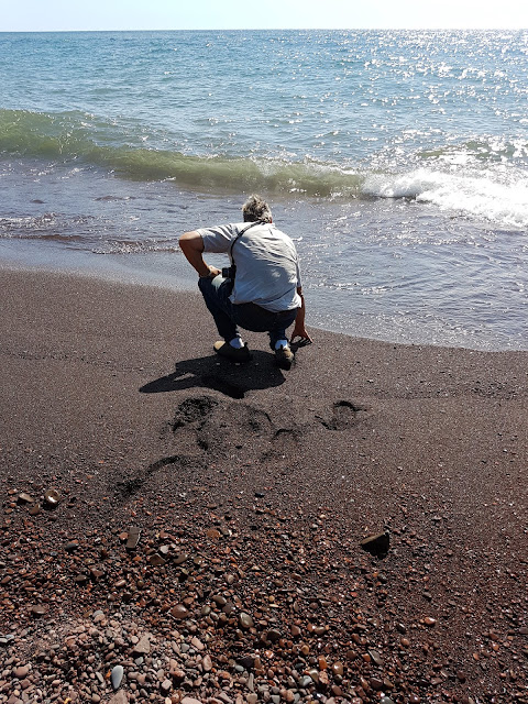 man testing water temperature  of Lake Superior