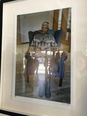 Oscar Gutierrez photograph of Nelson Mandela with reflections of people