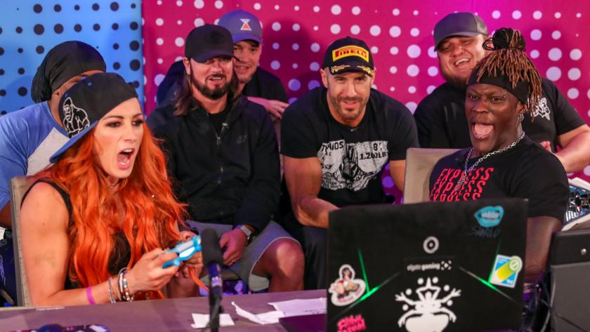 Becky Lynch, Xavier Woods, Cesaro, AJ Styles, R-Truth, Baron Corbin, and Samoa Joe playing on UpUpDownDown