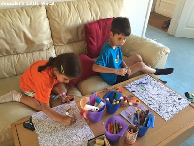 Children colouring together