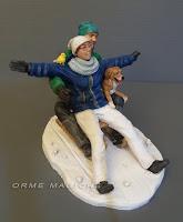statuetta coppia slitta sulla neve ricordo anniversario cake topper cane canarino orme magiche