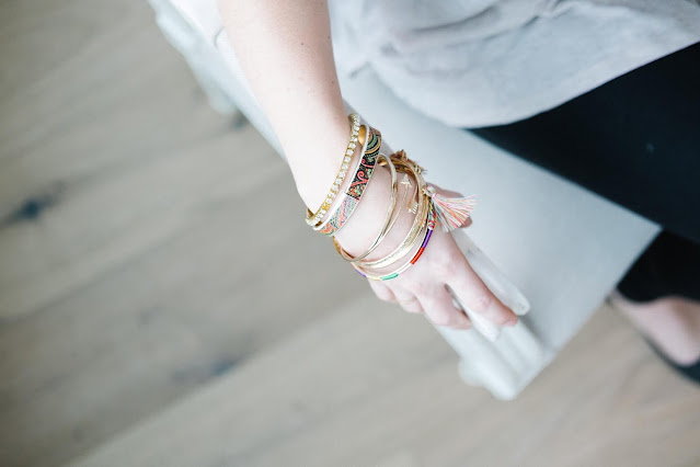 Close up of a person's arm with a focus on their bracelets.