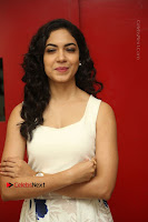 Actress Ritu Varma Stills in White Floral Short Dress at Kesava Movie Success Meet .COM 0074.JPG