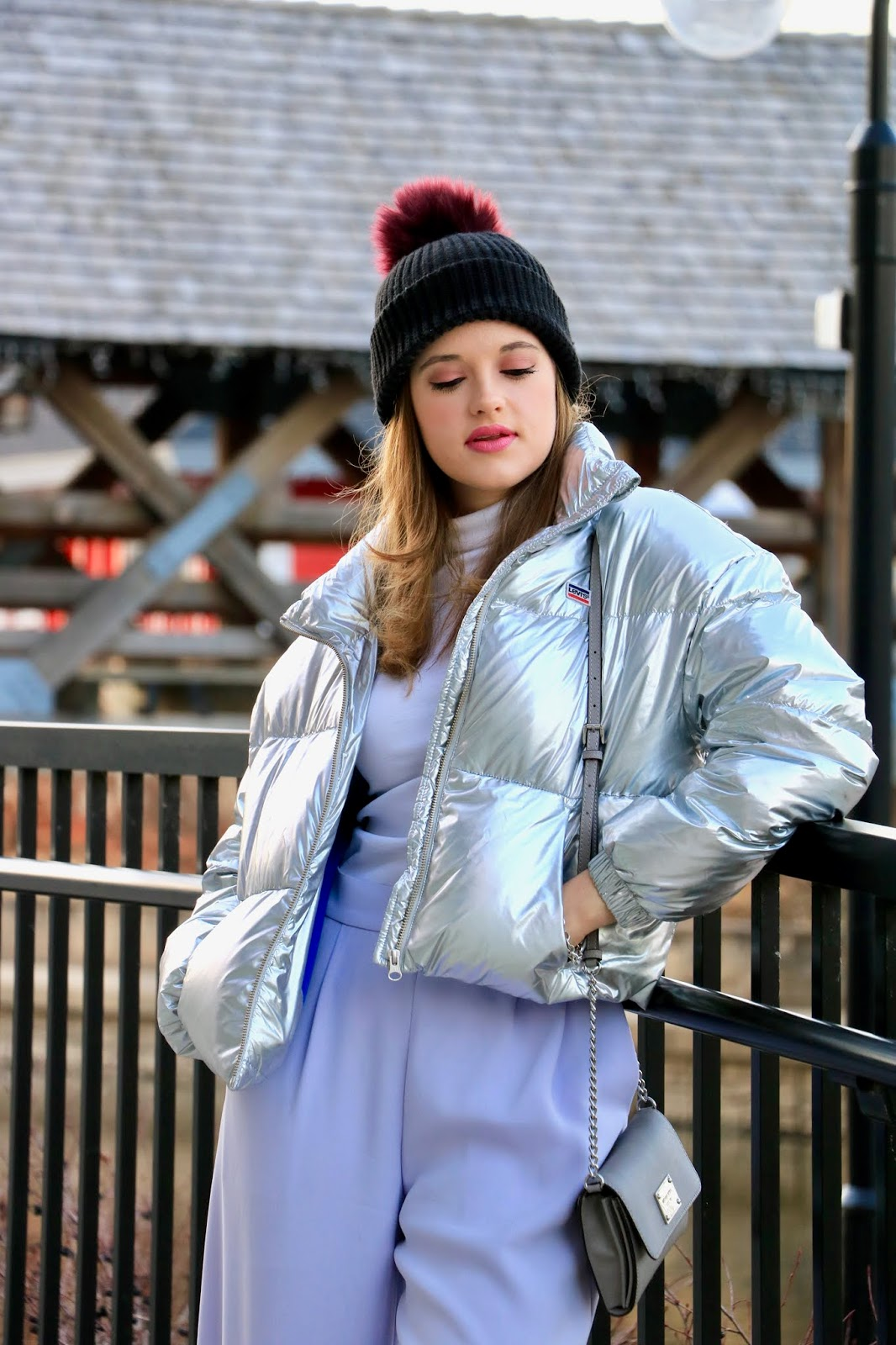 Nyc fashion blogger Kathleen Harper wearing a Levi's silver puffer coat.
