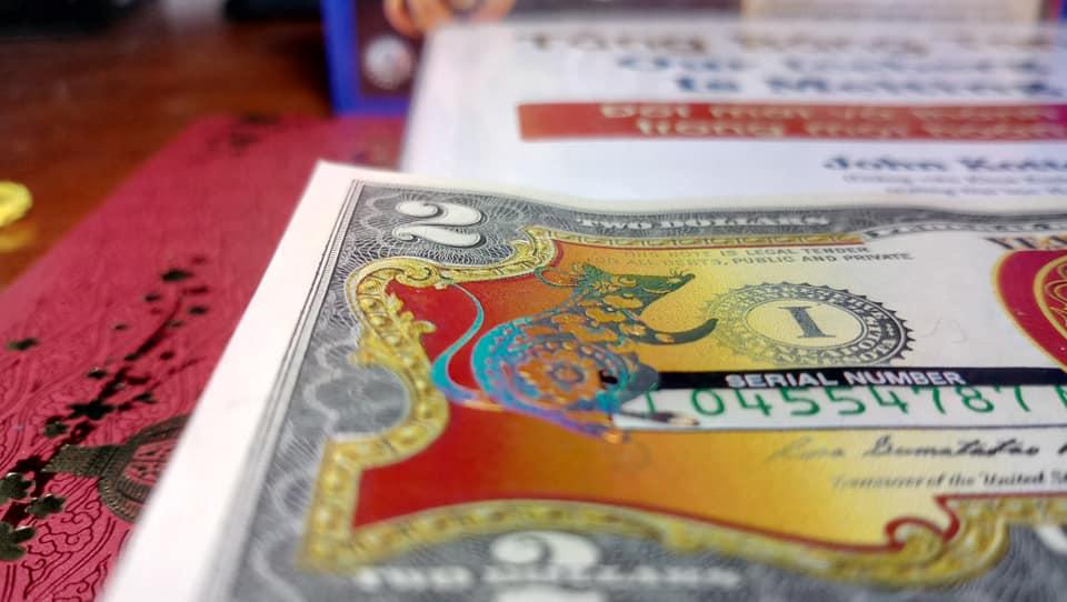 """Bán Tiền 2 USD mạ vàng - quà lì xì """"hot hit"""""""