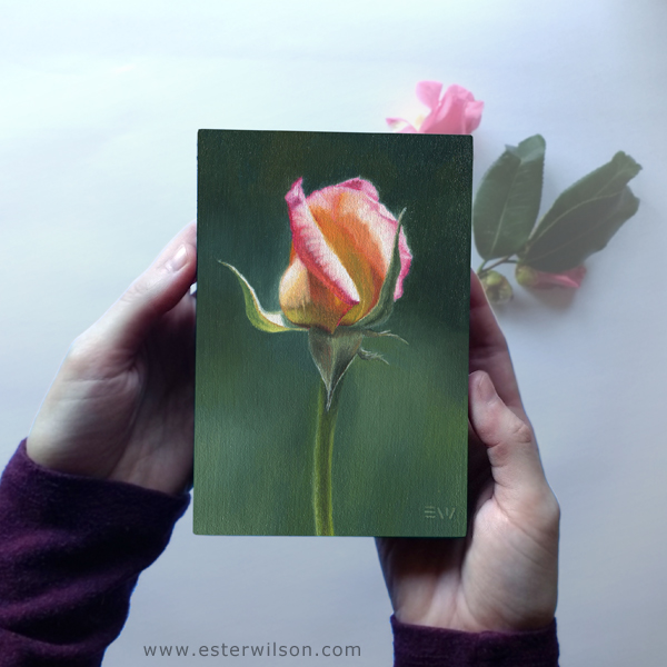Rose painting being held in hand