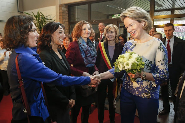 Queen Mathilde of Belgium attend a meeting during a visit to project 'Une etoile, un Destin, style royal weddings royal tiara, diamond, gold earrings