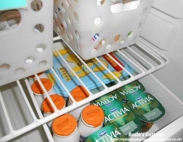 "Refrigerator organization using bins - extra yogurts, health drinks & dairy spread make up our ""extras"" bin."