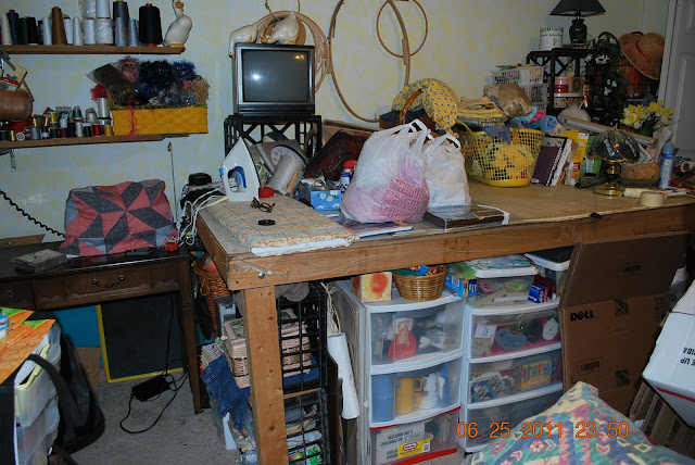 http://joysjotsshots.blogspot.com/2011/07/sewing-room-reveal.html